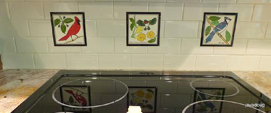 "Cardinal Tile,Hummingbird Tile,Bluejay Tile mounted in a stovetop tile backsplash combined with 4""x*' subway tiles"